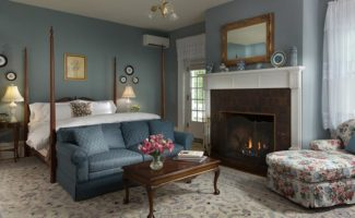 A seat next to the fireplace in Prospect View at the Mercersburg Inn