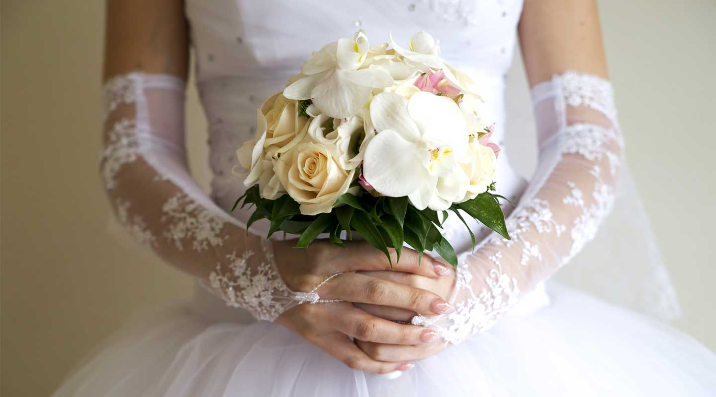 The eloping bride, holding her bouquet