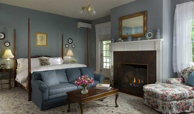 A luxury room with a fireplace at the Mercersburg Inn