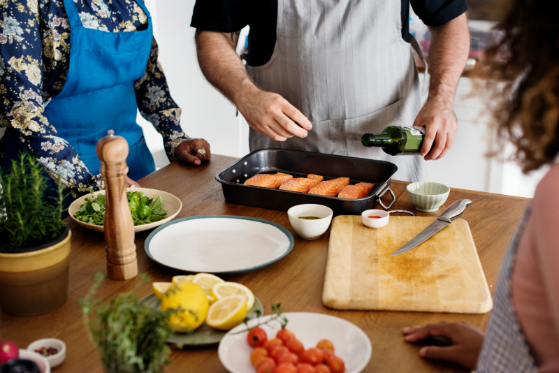 People Learning to Cook from Chef