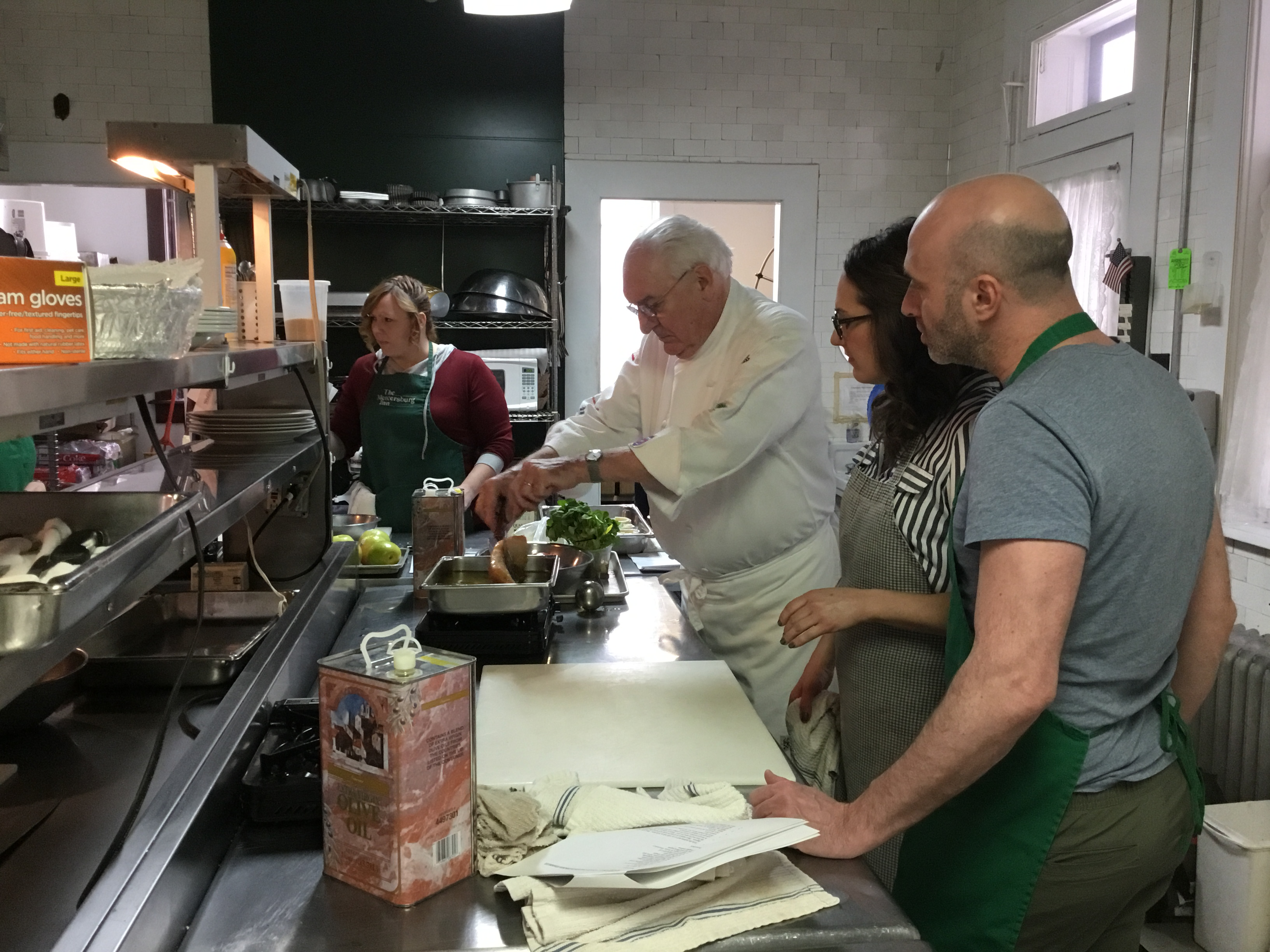 Participants cooking in French Cooking Class