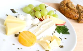 Assorted cheese and fruit with pastries