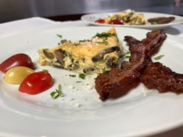 Mushroom quiche, bacon and cherry tomatoes for breakfast