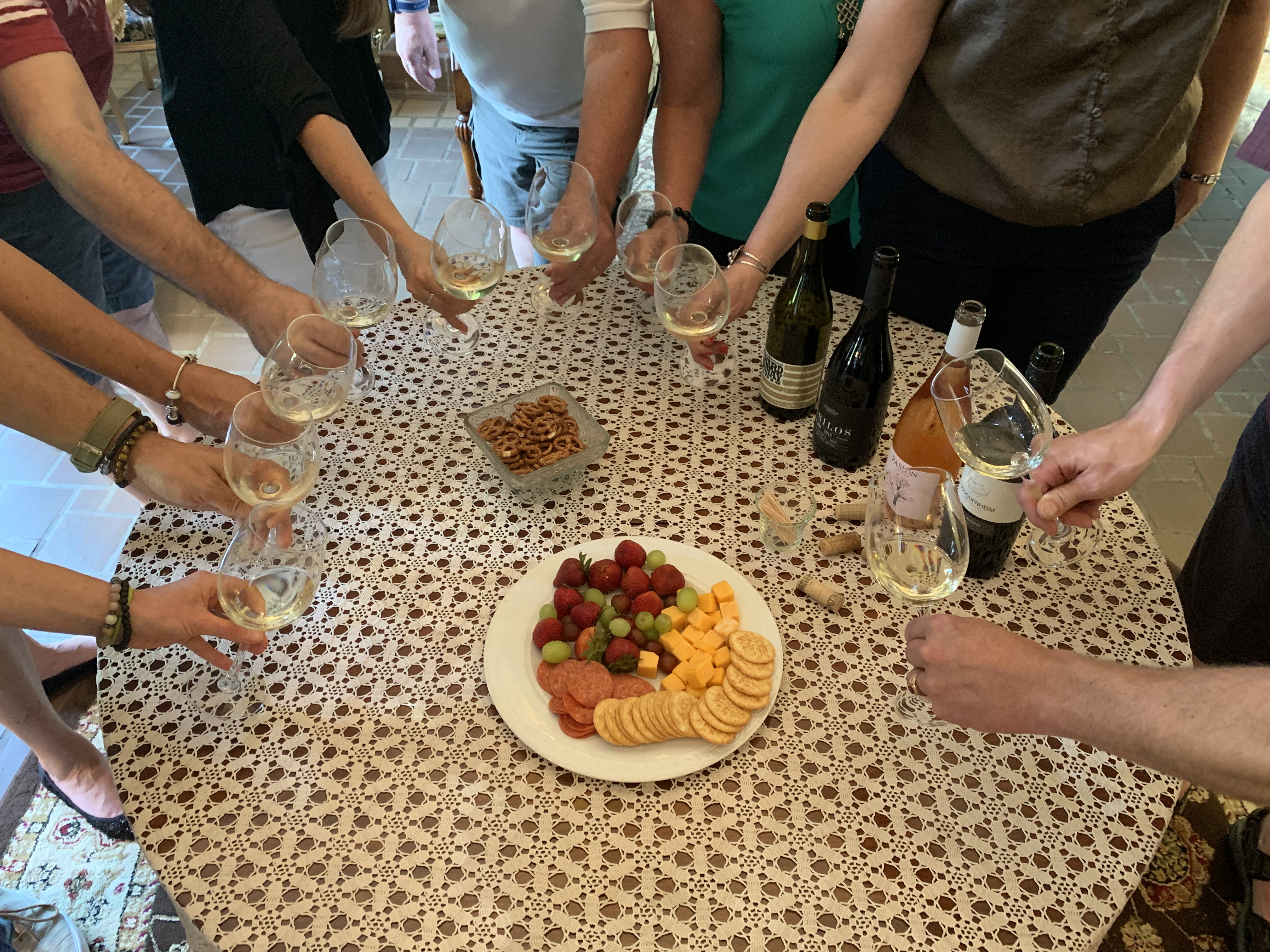 Wine, fruit, cheese and crackers at wine tasting event