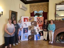 Quilting Weekend instructor and participants with the project
