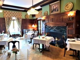 Historic formal dining with tables, chairs and fireplace at the Mercersburg Inn