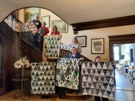 Quilting Weekend: Students with their quilt projects on the staircase