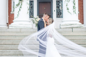 Bride and groom kissing at their romantic Pennsylvania wedding