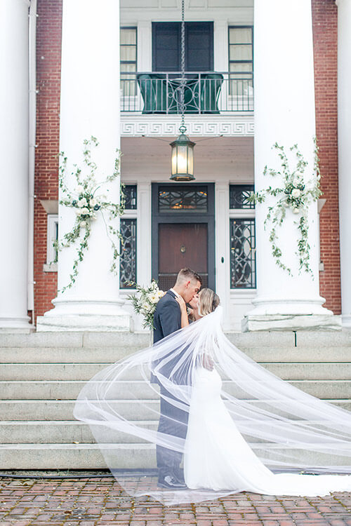 Wedding couple kissing in front of the Mercersburg Inn