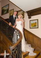 Happy bride and groom on the stairs at their beautiful Pennsylvania wedding