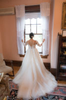 A bride looking at the window