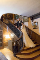 The bride and groom on the stairs