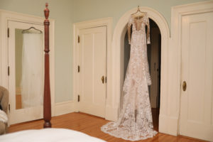 A wedding dress hanging on the wall in a guest room