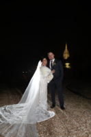A wedding couple with the background of the chapel