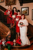 A bride and 3 bridesmaids on the staircase