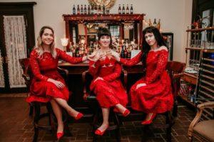 3 bridesmaids at the bar