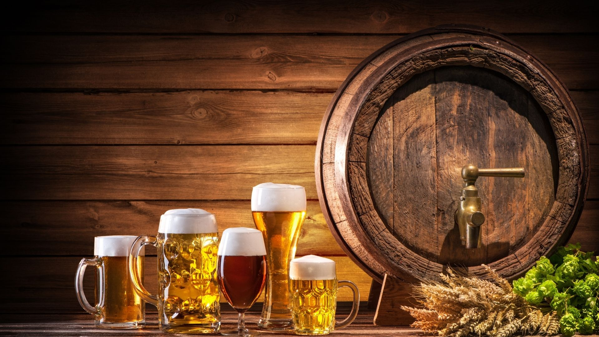 A barrel and several kinds of craft beer
