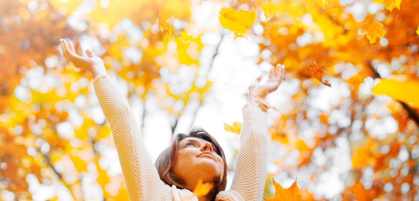 A woman in fall foliage